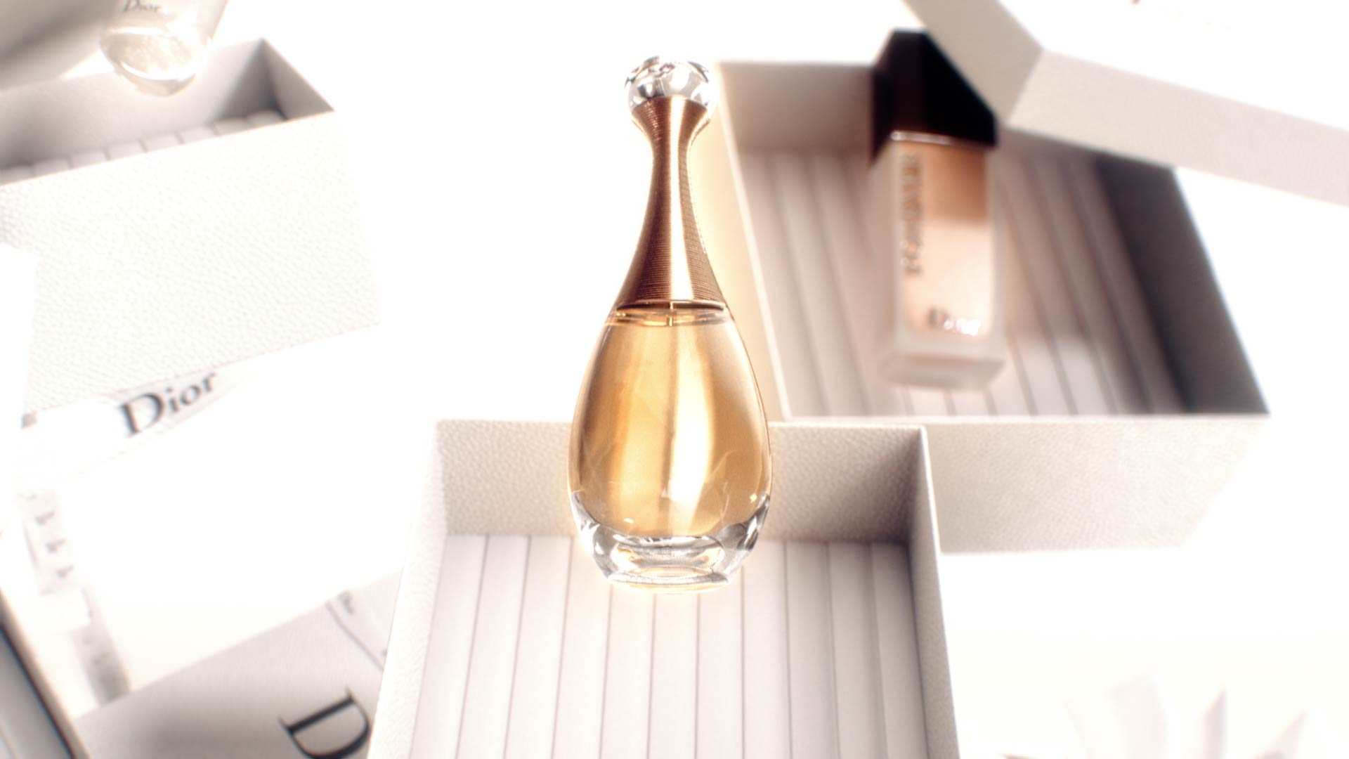 3D render of J'Adore Dior fragrance bottle in a motion design animation