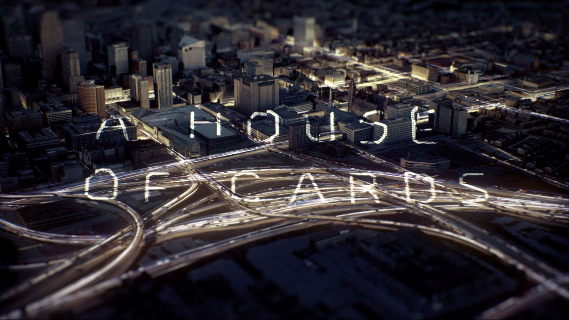 Aerial city shot with luminous particles flow and a text projected with 3D camera mapping